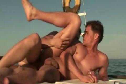 Two wild men pounding unfathomable On A Boat On The Water