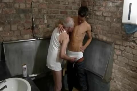 worthwhile Looking old man & young man engulf Each Other In A Public